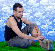 Free Man Sitting On Green Grass And Listening Radio Royalty Free Stock Photography - 6279627