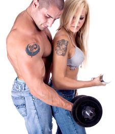 Young Couple Hang Up Weights Stock Image