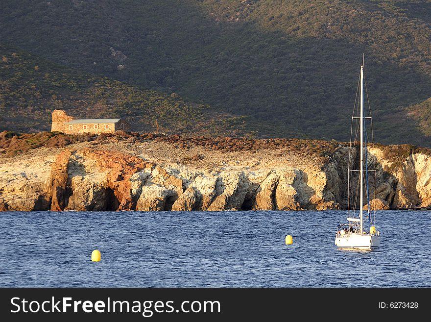 Sailing yacht at anchor evening Corsica