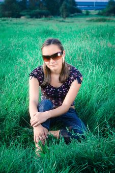 Free Girl Sitting In Grass Stock Photo - 6282380