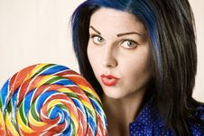 Free Pretty Woman With A Lollipop Royalty Free Stock Images - 6283689