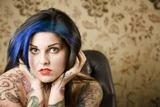 Free Pretty Woman With Tattoos In A Leather Chair Royalty Free Stock Photography - 6283857