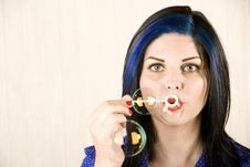 Pretty Woman Blowing Bubbles Stock Photography