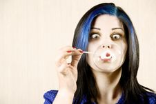 Free Pretty Woman Blowing A Bubble Stock Photography - 6284052