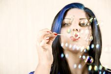Pretty Woman Blowing Bubbles Stock Photo