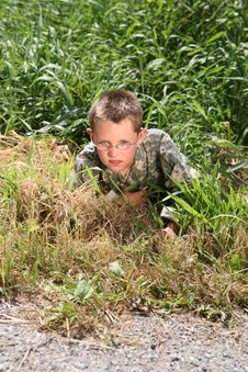 Free Young Child In Cammoflage Crawling Stock Image - 6284301