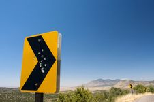 Gun Shot Holes Through A Rural Road Sign Stock Image