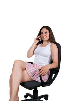 Free Pretty Girl Smiling With Phone In Office Chair Royalty Free Stock Image - 6287956