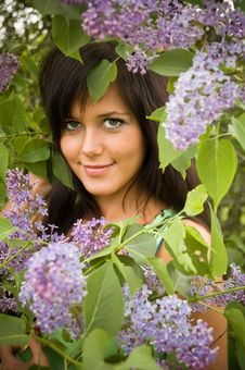 Free The  Girl And Blossoming Lilac Stock Photos - 6289873