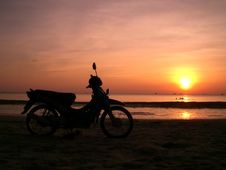 Free Motor Bicycle On The Sunset Beach. Royalty Free Stock Images - 6290839