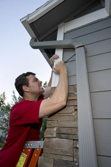 Free Man Fixing House Royalty Free Stock Photo - 6295485