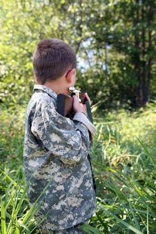 Free Young Boy Outside Sighting In A Rifle Stock Photo - 6296060