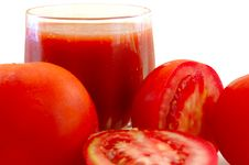 Fresh Tomato Juice In Glass And Tomatoes. Royalty Free Stock Images