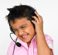 Free Boy Wearing Head Phones Stock Image - 6298281