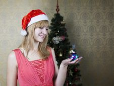 Free Young Girl Holding A Christmas Toy Stock Photo - 62941150