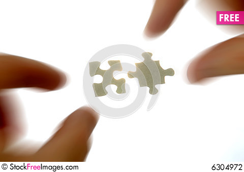 Free Hands And Puzzle Pieces Stock Photography - 6304972