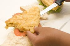 Free Hand Making An Spanish Omelet Sandwich Royalty Free Stock Images - 6300109