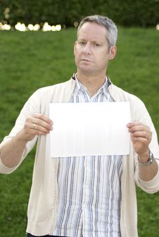 Free Young Man Holding A Blank Sign Stock Photos - 6301093