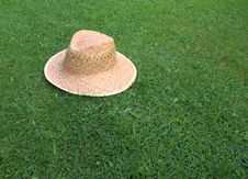 Free Straw Hat On Grass Lawn. Royalty Free Stock Images - 6302109