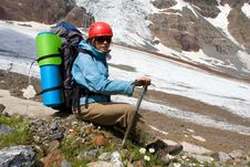 Backpacker Girl With Ice-axe Royalty Free Stock Images