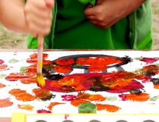 Kid Painting The Picture Stock Photo