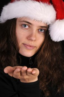 Attractive Young Woman In Santa Hat Royalty Free Stock Photography