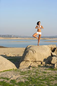 Free A Young Woman On Top Of A Rock Doing Yoga Royalty Free Stock Photos - 6311438