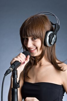 Free Woman In Headphones Singing Into Microphone Stock Photo - 6311560