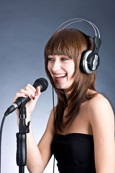 Free Woman In Headphones Singing Into Microphone Stock Photography - 6311642