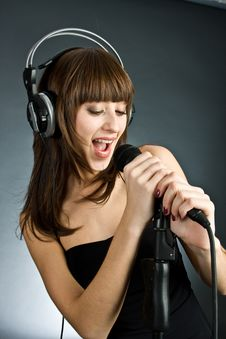 Free Woman In Headphones Singing Into Microphone Stock Photo - 6311670