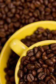 Free Coffee Beans In A Yellow Cup Royalty Free Stock Image - 6311866
