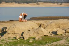 A Young Woman On Top Of A Rock Doing Yoga Stock Photography