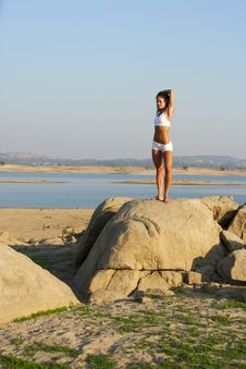 Free A Young Woman On Top Of A Rock Doing Yoga Royalty Free Stock Photo - 6312155