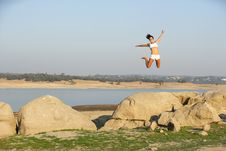 Free A Woman Jumps For Joy Royalty Free Stock Photography - 6312247