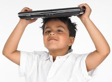 Free Boy Holding Laptop On His Head Stock Photos - 6319043