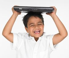 Free Boy Holding Laptop On His Head Royalty Free Stock Images - 6319069