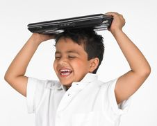 Free Boy Holding Laptop On His Head Stock Images - 6319954