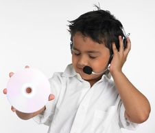 Free Boy Holding Cd With Headphone Royalty Free Stock Photos - 6319968