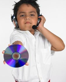 Free Boy Holding Cd With Headphone Stock Photos - 6319973