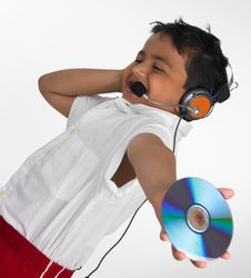 Free Boy Holding Cd With Headphone Royalty Free Stock Photo - 6319975