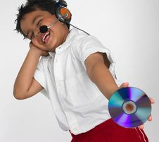 Free Boy Holding Cd With Headphone Stock Photography - 6319982