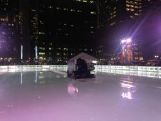 Free Ice Skating Rink At Bryant Park In The Evening. Stock Photography - 63191632