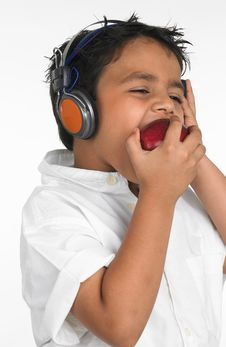 Free Boy Biting A Red Apple Royalty Free Stock Photo - 6320045