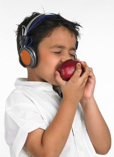 Free Boy Biting A Red Apple Stock Image - 6320061