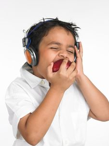 Boy Biting An Red Apple Stock Photo