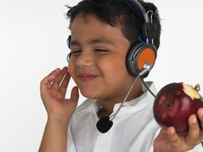Free Boy Biting An Red Apple Stock Photos - 6320083