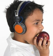 Free Asian Boy Biting A Apple Royalty Free Stock Photo - 6320095
