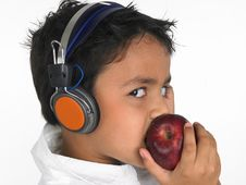 Free Asian Boy Biting A Apple Stock Image - 6320111