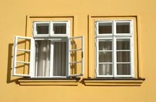 Two Windows On Yellow Wall Stock Images