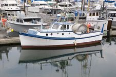 Free Blue And White Boat In Harbor Stock Image - 6320861